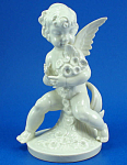 Click here to enlarge image and see more about item p00438: Vintage German Porcelain Cherub with Flowers