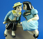 Click here to enlarge image and see more about item p00442: Ceramic Arts Studio Shelf Sitter Young Love Pair