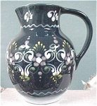 Click here to enlarge image and see more about item pt00386: Handpainted Slip Glaze Gmundner Austria Jug