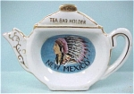 Click here to enlarge image and see more about item pt00421: Teapot Shaped Tea Bag Holder