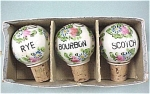 Three Handpainted Porcelain Liquor Corks