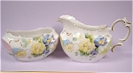 Click here to enlarge image and see more about item pt00614: c1900 Handpainted Porcelain Cream and Sugar