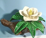 Unmarked Pottery Flower on Log