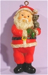 Click here to enlarge image and see more about item s00077: 1976 Hallmark Santa With Kitten Ornament