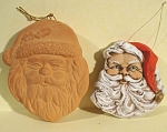 Two Pottery Santa Face Ornaments