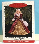 Click here to enlarge image and see more about item s00153: Hallmark Ornament Holiday Barbie, 1995
