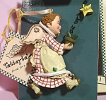Click here to enlarge image and see more about item s00195: 1999 Tattertails Peace Angel Ornament