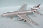 Click here to enlarge image and see more about item t00431: Miniature Diecast DC-10 Airplane
