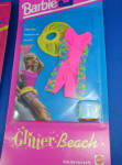 Click here to enlarge image and see more about item t01552: 1992 Barbie Glitter Beach Clothes