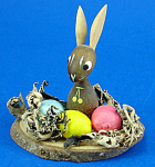 Click here to enlarge image and see more about item xa06238: Miniature Wood Easter Rabbit in Nest