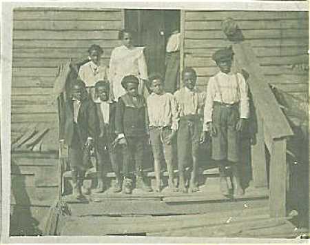 ANTIQUE PHOTO - BLACK CHILDREN ON STEPS OF HOUSE. (Image1)