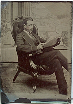 TINTYPE - CASUAL SHOT OF MAN READING PAPER. (Image1)