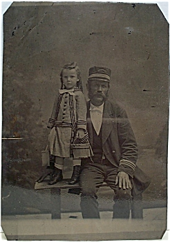 Tintype Of Steamboat Captain And Daughter.