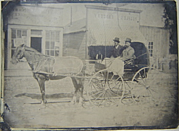 Tintype – C.1870 Buggy, Gun Store, and Grocery. (Image1)