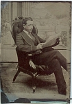 Click here to enlarge image and see more about item 1213: TINTYPE - CASUAL SHOT OF MAN READING PAPER.