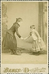 Click to view larger image of CABINET PHOTO – TWO KIDS BOWING-SHAKING HANDS (Image1)