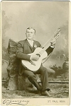 Click here to enlarge image and see more about item 4090: CABINET PHOTO of HARP GUITAR MUSICIAN C.1890