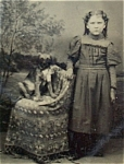 Click here to enlarge image and see more about item 4212: Tintype of a Girl with Her Puppy.
