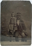 Click here to enlarge image and see more about item 4326: Tintype of Steamboat Captain and Daughter.