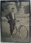 Click here to enlarge image and see more about item 4330: Tintype of Young Man with his Bicycle.