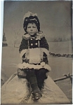 Click here to enlarge image and see more about item 4707: Tintype � Cute little girl with her muff.