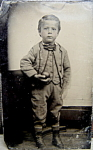 Click here to enlarge image and see more about item 5157: Tintype – Little boy holding apple or ball - C.1860's.
