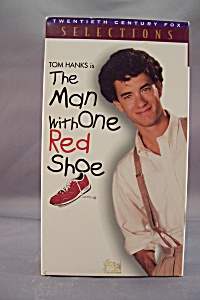 The Man With One Red Shoe (Image1)