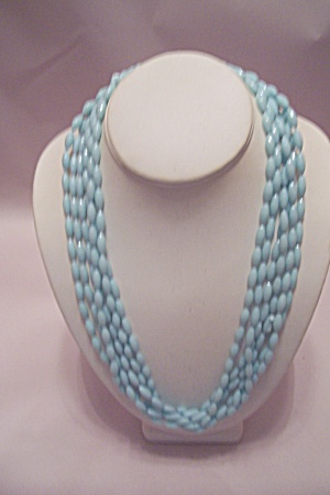 Light Blue Oval Beads Three Strand Necklace.