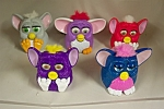 Nice set of 5 McDonald's Furbies issued in the 1990s.  Various colors and mechanisms.  As depicted in the photo.
