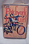 A nice edition of L. Frank Baum's THE PATCHWORK GIRL OF OZ published (copyright) in 1913 by The Reilly & Lee Co., Chicago.  Illustrated profusely by John R. Neill.  Boards are in good shape with modest amount of wear for its age.  Interior has the name of a previous owner inside the front and on the two front end-pages.  Text pages and illustrations are clean.  No torn pages.  Several pages have wrinkled corners on the bottom front from improperly closing of book.  Overall condition is fair to good.  See Photos.