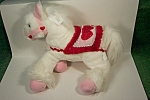 Cute pink and red decorated white stuffed pony.  Made in China for Commonwealth Toys.  12 inches tall and 14 inches long.  2002.  Very clean and as new condition.