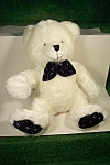Cute white stuffed bear with blue bow tie and blue soles of feet.  20 inches tall.  Made in China.  Circa 2000.  Very clean.