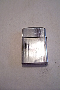 Rogers Cigarette Lighter. (Image1)