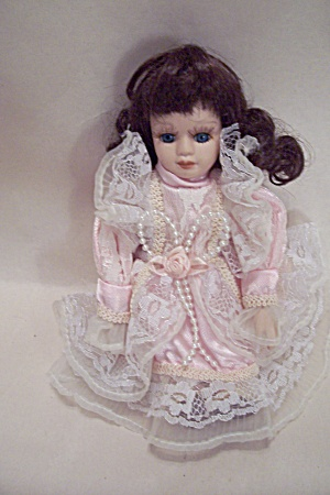 Porcelain Doll In Pink Dress