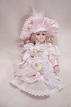 Porcelain Doll Dressed In Pink Outfit (Image1)