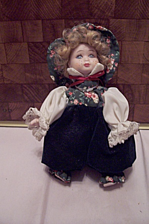 China Blonde Girl Doll In Floral Outfit (Image1)