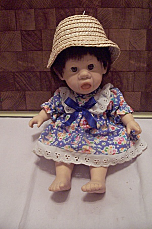 Little Baby Girl Doll In Blue Floral Dress (Image1)
