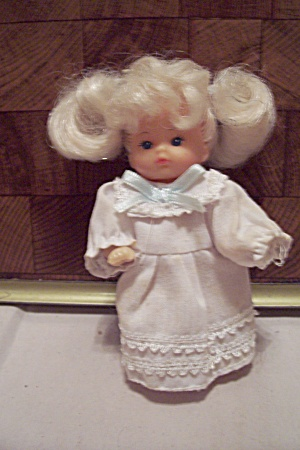 Miniature Blonde & Blue Eyed Doll In White Dress (Image1)