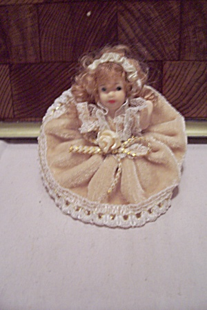 Miniature Blonde Girl China Sitting Doll
