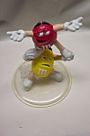 Click here to enlarge image and see more about item ADMM009: M & M  Cheerleading Pair