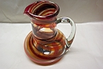 Click to view larger image of Cased Orange And Black Art Glass Pitcher (Image1)