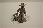 Click here to enlarge image and see more about item DFP001: Cowboy With Saddle