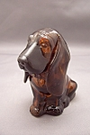 Click here to enlarge image and see more about item FAC00089: Avon Amber Glass Dog Bottle
