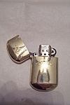 Click here to enlarge image and see more about item FAC00117: Gold Tone Camel Lighter