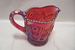 Click here to enlarge image and see more about item FAC00657: Indiana Carnival Amberina Glass Creamer