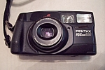 Click here to enlarge image and see more about item FAC00672: Pentax IQZoom900 35mm Camera