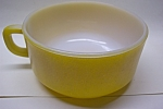 Click here to enlarge image and see more about item GFK141: Fire King Yellow Handled Soup Bowl