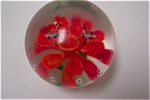 Beautiful art glass paperweight with two butterflies flying over an orange flower with green leaves and ring of controlled bubbles.  3 inches in diameter and 2-3/4 inches in height.  Made in China cir...