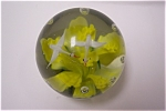 Beautiful art glass paperweight with two white swans flying over a yellow flower with green leaves and ring of controlled bubbles.  3 inches in diameter and 3 inches tall.  Made in China circa 1990s. ...