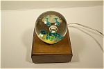 Nice crystal paperweight with two swimming dolphins, large bubble, and blue stone design on bottom.  Unsigned and 3 inches in diameter.  Free of any damage.  Has one tiny internal speck which was part...